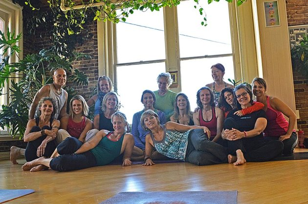 Here's our group picture! The only male, Jeff Rule is the owner of the studio. I am in the center, in green. In front of me, in blue is Mary Flinn, guest instructor. Next to her is Kathy Falge. Kathy and Jeff are my Ashtanga instructors. Also present are three instructors of mine that teach Vinyasa flow and Kripala.